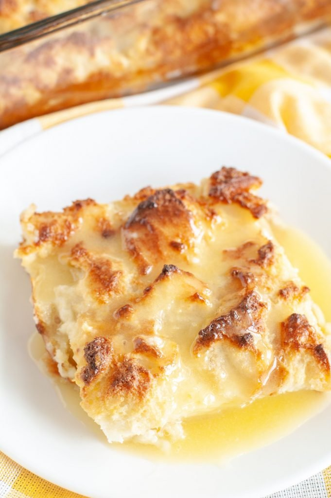 Amaretto Bread Pudding on a plate with sauce