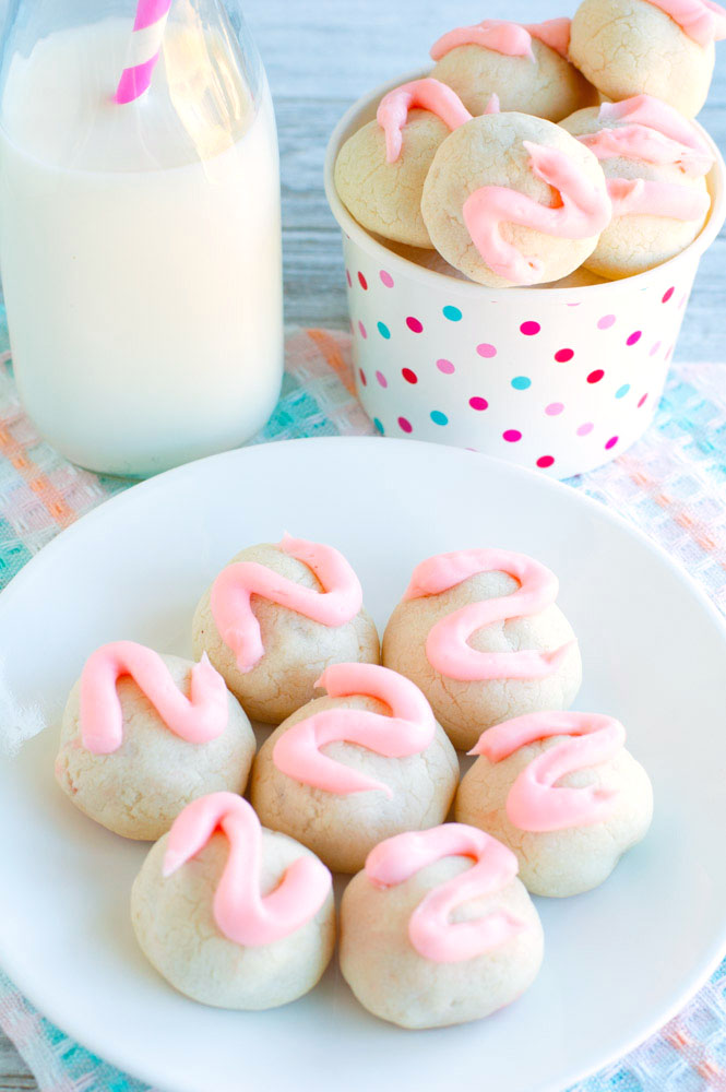 Cherry bon bon cookies on a plate with milk