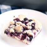 Piece of blueberry cake on plate.