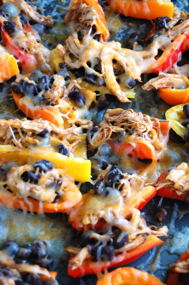Peppers filled with shredded chicken and black beans.