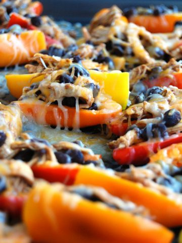 Peppers filled with black beans, chicken and cheese.