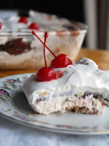 Robert Redford dessert on a plate with cherries.