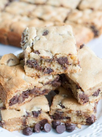 Chocolate chip bars cut into squares on a plate.
