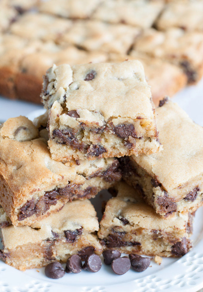 Congo Squares stacked on a plate with chocolate chips