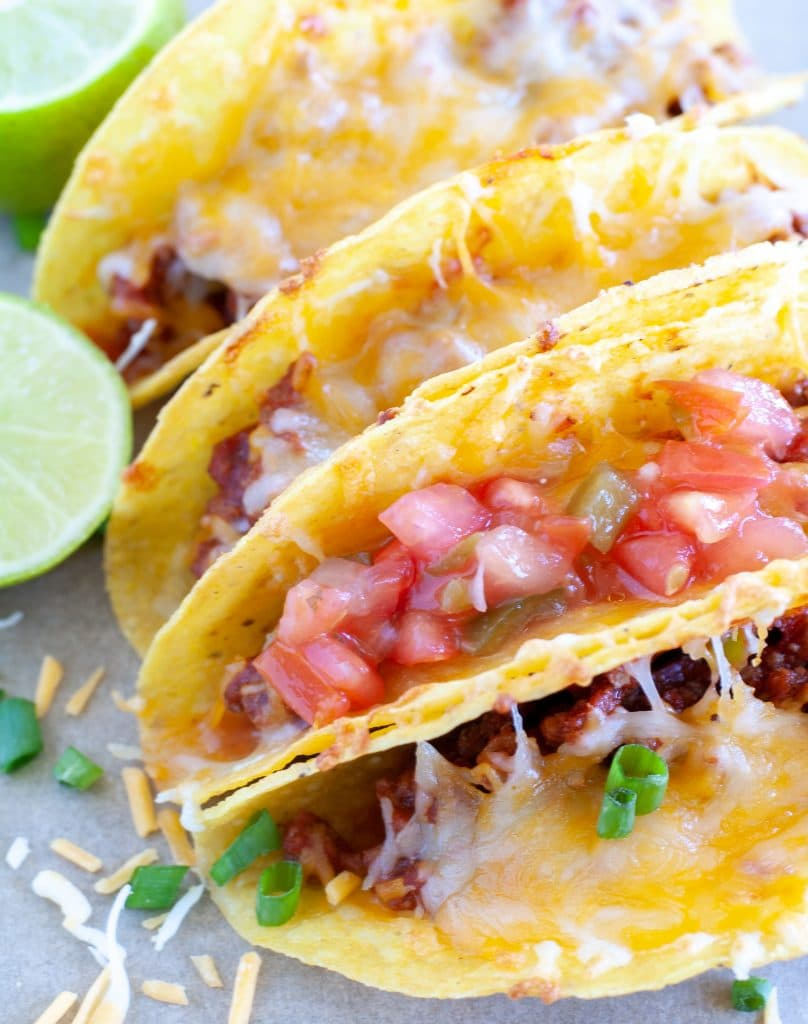 Tacos with salsa, and cheese