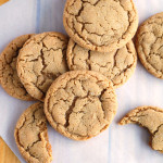 Stack of ginger cookies on board.