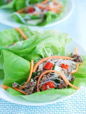 Plate with lettuce leaf and ground beef mixture.