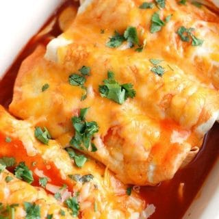 enchiladas in baking dish topped with cheese