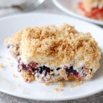 Plate with blueberry and graham cracker dessert.