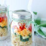 Jar filled with pasta salad.