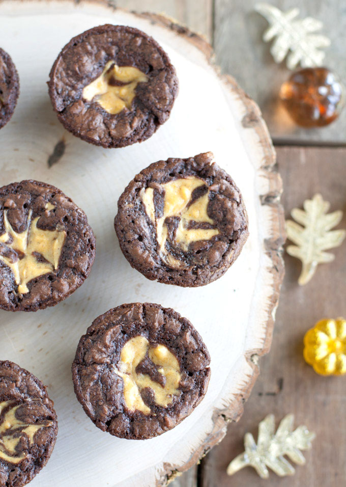 Delicious little brownie bites with a hint of pumpkin cheesecake swirl. Pumpkin cheesecake brownie bites are a great sweet treat to make for any party.