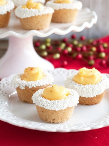 Three cookie cups on a plate.