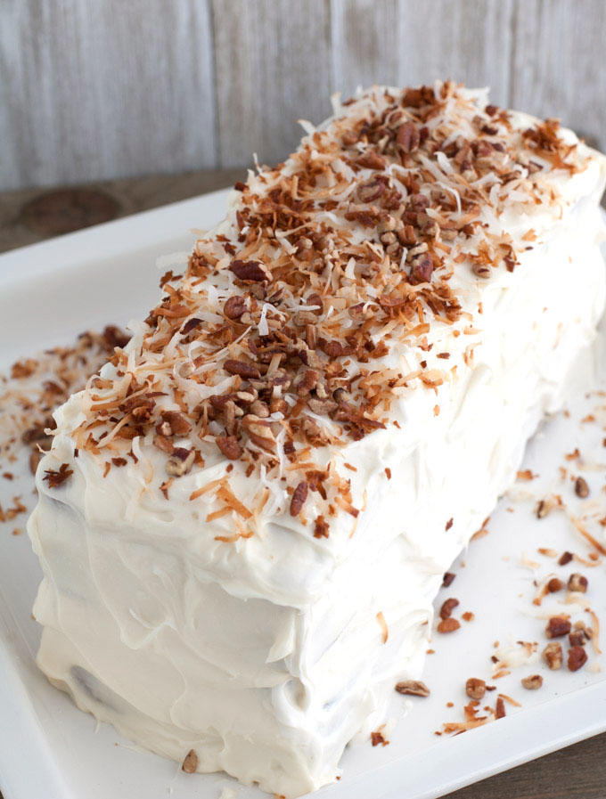 Layered coconut spice cake with cream cheese frosting is a cake sure to impress your guests. Filled with warm spices, coconut and chopped pecans, this cake has texture and amazing flavors.