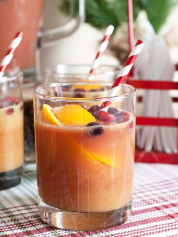 Glass with juice and sliced oranges.