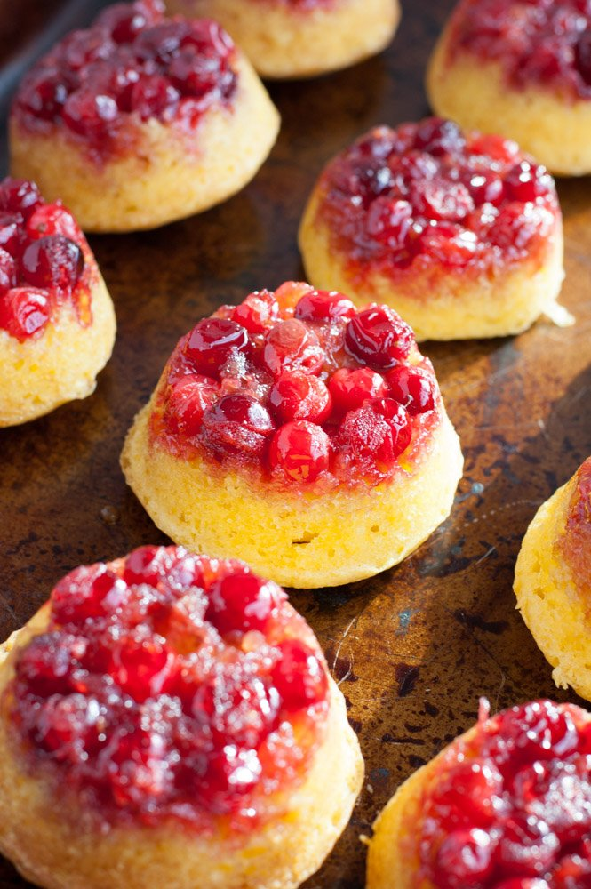 Small cakes topped with cranberries.