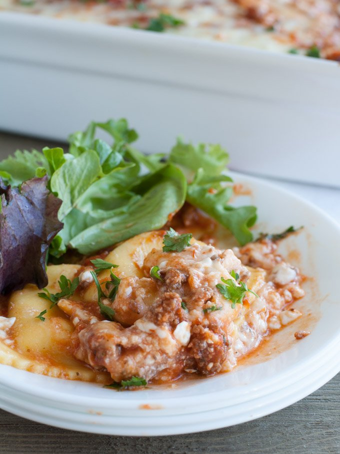 Baked Ravioli Lasagna on a plate with salad