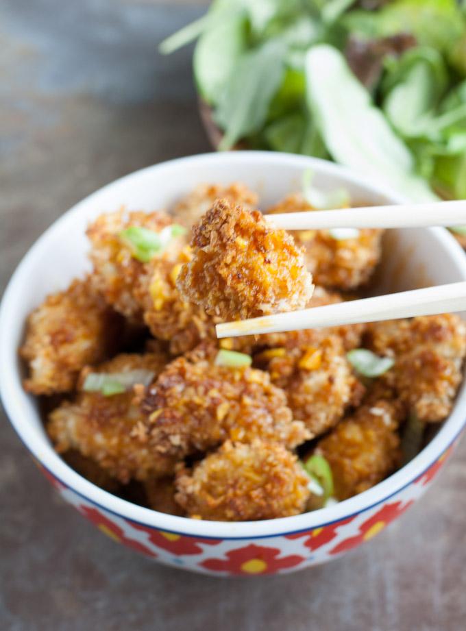 turmeric chicken nugget in chopsticks