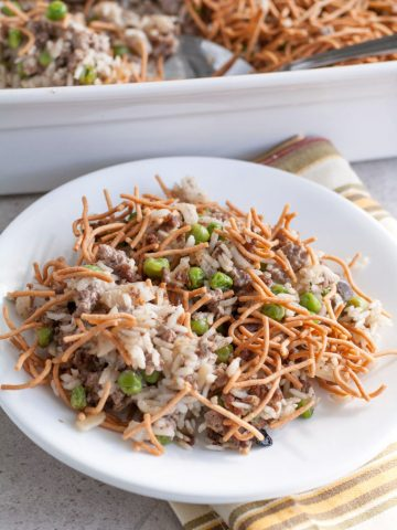 Beef and rice casserole with crunchy noodles on plate.
