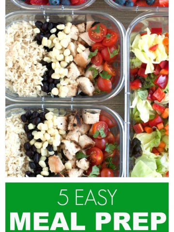 Container with strawberries, salad and chicken, rice and corn.