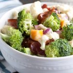 Bowl of broccoli, cauliflower, bacon and cheese.
