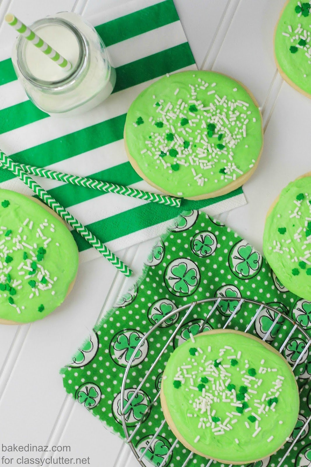 Sugar Cookies covered in green frosting and sprinkles