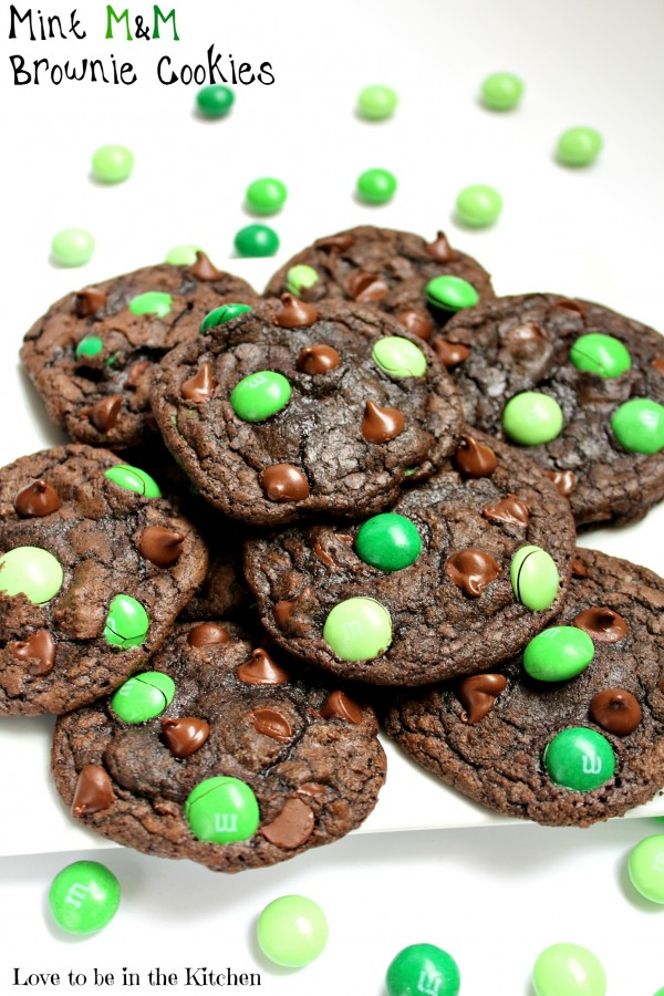 Chocolate cookies with green M&M's on plate
