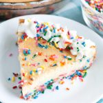 Plate of cheesecake with sprinkles.