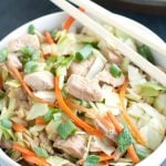 Bowl with diced pork and cabbage with chop stick