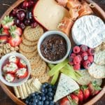 Plate with crackers, fruit and cheese.