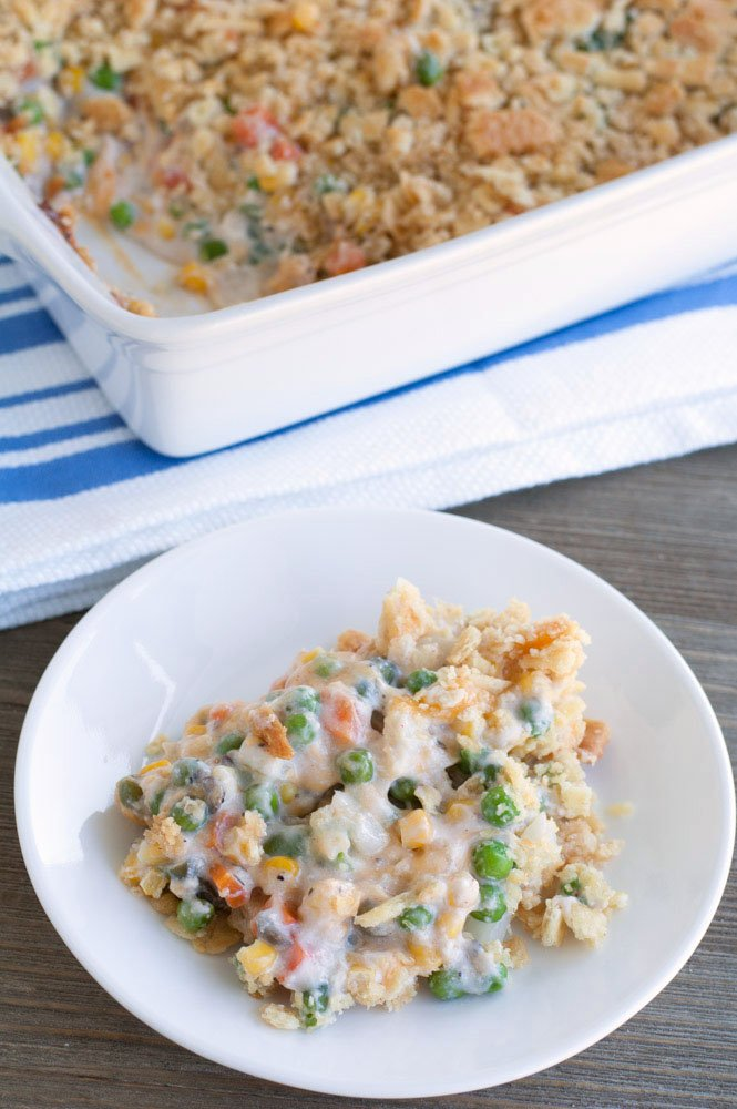 Plate of casserole with peas and carrots.