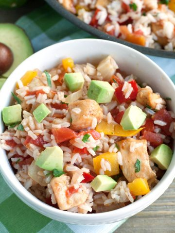 Bowl filled with rice and diced chicken.