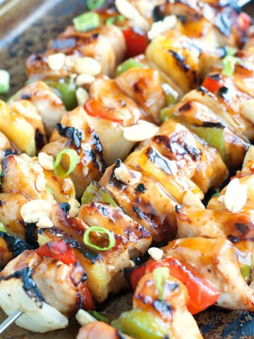 Grilled chicken and pineapple on a skewer.