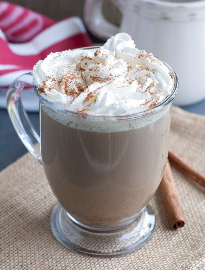 Latte in a mug with whipped cream