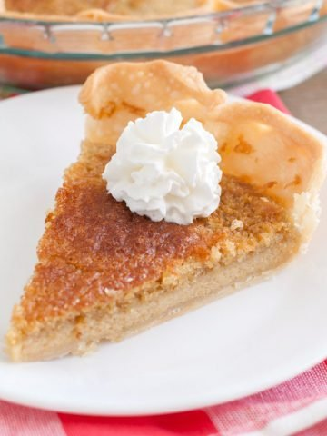 Piece of chess pie on a plate.