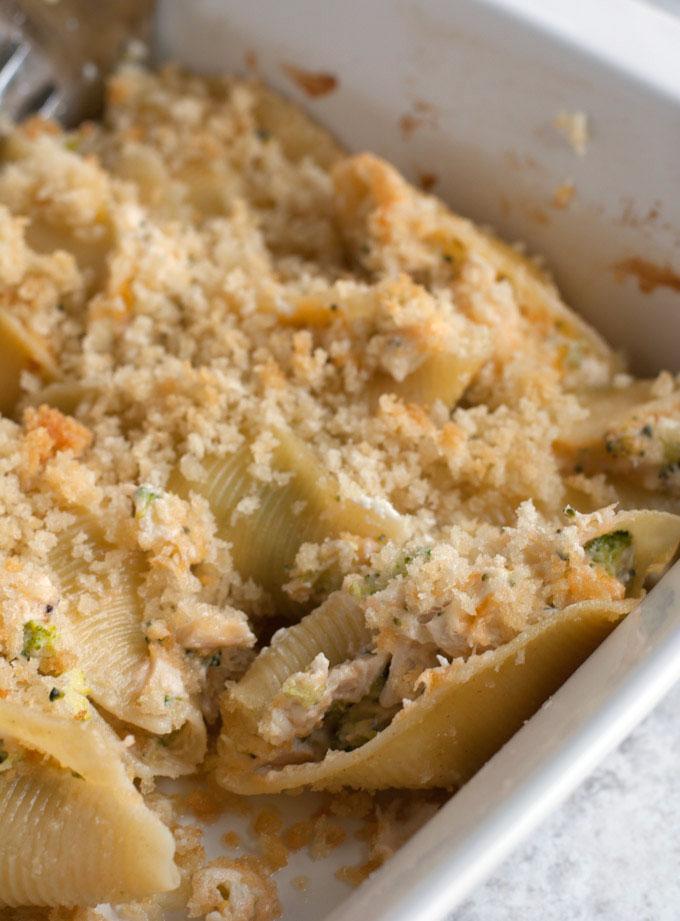 Stuffed pasta shells in baking dish.