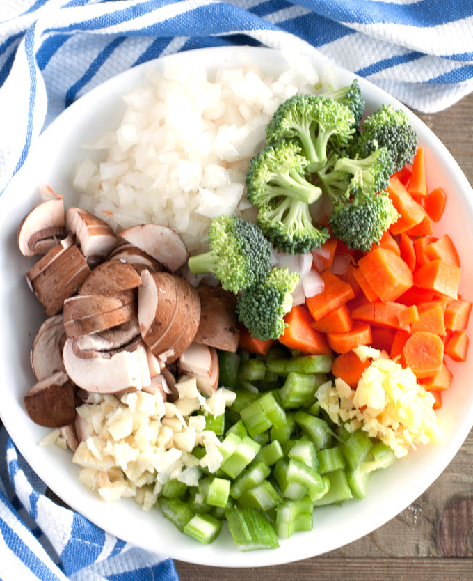 Bowl with mushrooms, onions, broccoli, carrots, celery, garlic