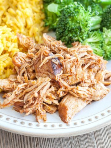 BBQ shredded chicken, rice, broccoli on plate.