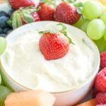 Bowl with creamy fruit dip surrounded by fruit.