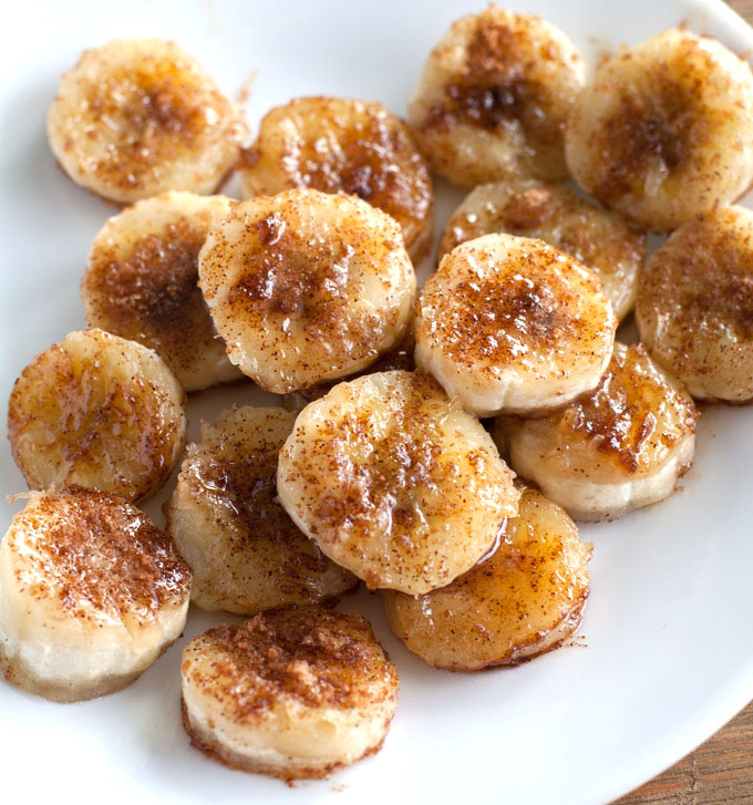 Bananas with cinnamon and sugar on a white plate