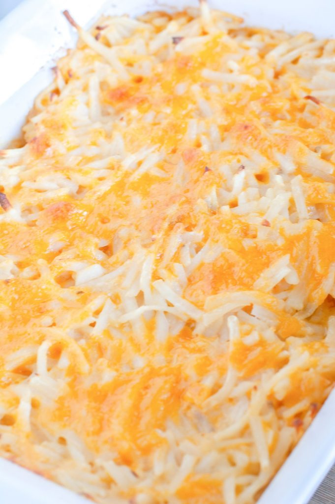 Baked hashbrown casserole in a casserole dish