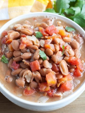 Bowl with beans and tomatoes.