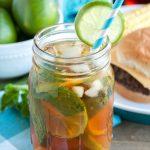 Mason jar with tea, mint and lime slice.