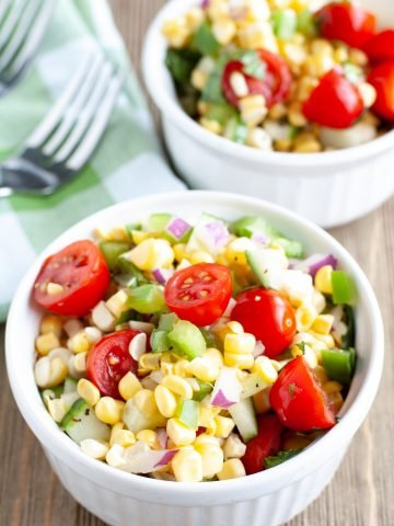 Two bowls of corn salad.