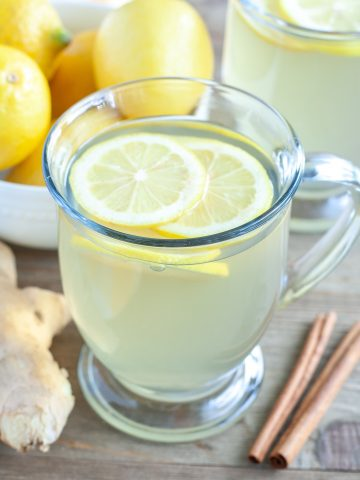 Glass coffee cup with tea and lemon.