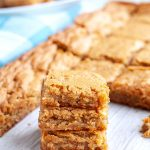 Blondies stacked on table.