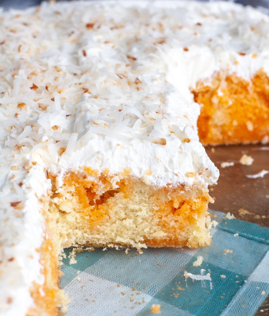 Orange Poke Cake in Baking Dish, cut