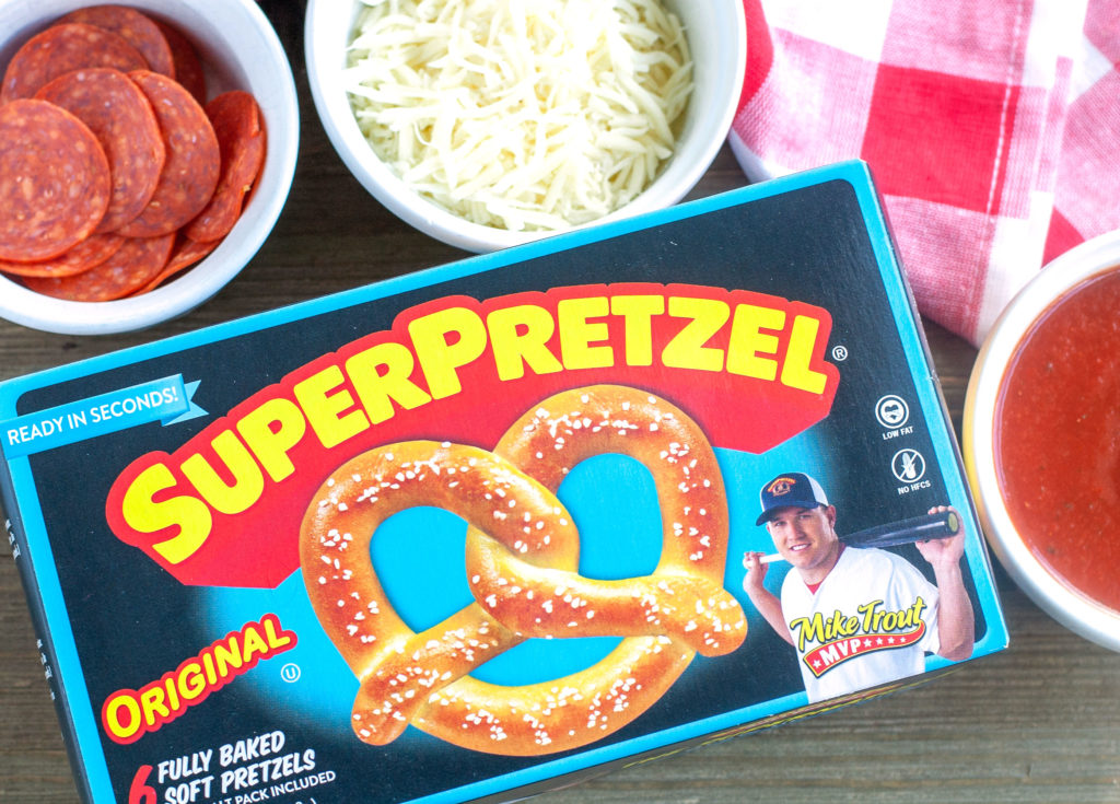 Box of Super Pretzels on table with bowl of pepperoni and cheese.