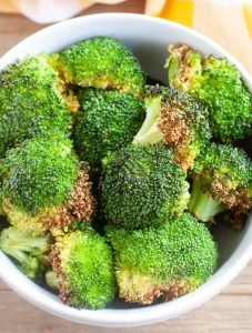 Roasted broccoli in a bowl.