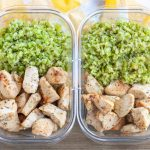 Container with chicken and riced veggies.