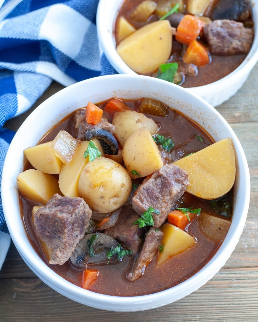 2 bowls of slow cooker beef stew and a napkin